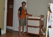 Aaron wearing the Ergo carrier (with stuffed dog)