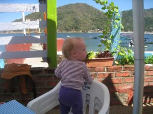 The Mexican 'high chair': 3 chairs stacked one on top of the other. It works quite well!  (For safety reasons, standing in your high chair is not recommended by occasionally tolerated to encourage further food consumption.)