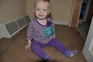 She found some old conference nametags in a box in my office...she was pleased as punch to wear this one.