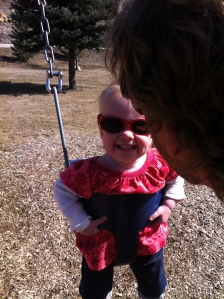 Smiling on the swing with Papa in Durango AND wearing sunglasses for almost 15 minutes!