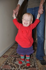 Happy girl! Walking a lot on her own but still likes to have hands to hold on to.