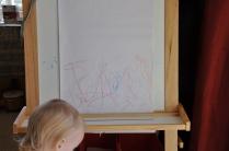 Art work on her easel.
