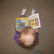 Reading her National Geographic Kids Magazine
