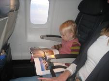 Reading a magazine on the plane