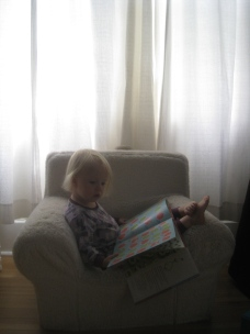 Reading in her big comfy chair