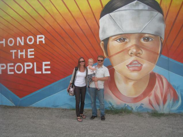 She is intrigued with the boy in this mural, which reads: HONOR THE PEOPLE -- PROTECT MOUNT TAYLOR