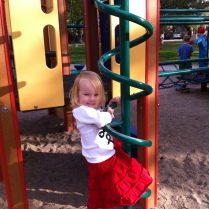 """Mastering the swirly slide-down bar...Now she says, """"Mama, don't help me. Stand waaaaay over there!"""""""