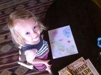 Drawing a picture/birthday card for her friend