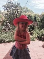 Posing in the fancy hat