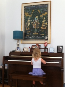 Playing piano at our friends' house