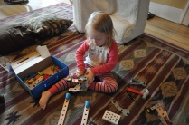 Using the wrench (to plunder parts for the house from her previously built car)